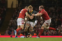 South Africa&rsquo;s Pieter-Steph Du Toit is tackled by Wales' Hadleigh Parkes and Alun Wyn-Jones<br /> <br /> Photographer Ian Cook/CameraSport<br /> <br /> Under Armour Series Autumn Internationals - Wales v South Africa - Saturday 24th November 2018 - Principality Stadium - Cardiff<br /> <br /> World Copyright &copy; 2018 CameraSport. All rights reserved. 43 Linden Ave. Countesthorpe. Leicester. England. LE8 5PG - Tel: +44 (0) 116 277 4147 - admin@camerasport.com - www.camerasport.com
