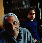 Mr Kazimerz Mirga, 73 - survivor - with one of his grandchildren. Kazimerz had a tough youth after the end of the war, with no family he had to fight for himself, and spend the time on the road working for people for food or begging until he joined a communist farm when he was 17. The Nazis picked up him and his whole extended family, Kazimerz was the only to return