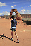 Getty Images exclusive, Girl hiking at Delicate Arch in Arches National Park, Moab, Utah, USA. .  John offers private photo tours in Arches National Park and throughout Utah and Colorado. Year-round.