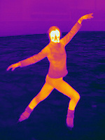 Thermogram of a woman ice skating.  The different colors represent different temperatures on the object. The lightest colors are the hottest temperatures, while the darker colors represent a cooler temperature.  Thermography uses special cameras that can detect light in the far-infrared range of the electromagnetic spectrum (900?14,000 nanometers or 0.9?14 µm) and creates an  image of the objects temperature..