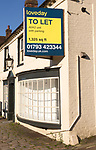 Loveday estate agent To Let sign commercial shop property,  High Street, Marlborough, Wiltshire, England, UK