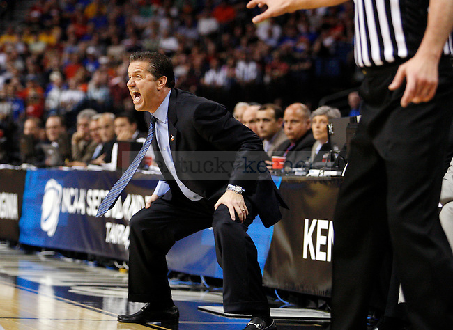 Coach Cal yells at the Cats in the first half of UK's second round NCAA tournament win, 71-63, against West Virginia at the St. Pete Times Forum in Tampa, Florida on Saturday, March 19, 2011.  Photo by Britney McIntosh | Staff