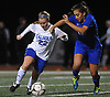 Annie Coogan #22 of Calhoun, left, gets pressured by Ava Sann #29 of Port Washington during the Nassau County varsity girls soccer Class AA semifinals at Cold Spring Harbor High School on Monday, Oct. 30, 2017. Coogan scored Calhoun's second goal in the team's 3-0 win.