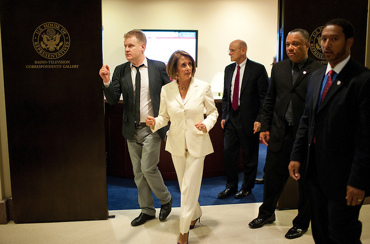 UNITED STATES - OCTOBER 13:  House Minority Leader Nancy Pelosi, D-Calif., and her staff leave her a news conference in the Capitol Visitor Center where she and democratic leaders spoke on reduction of the national debt and job creation.  (Photo By Tom Williams/Roll Call)