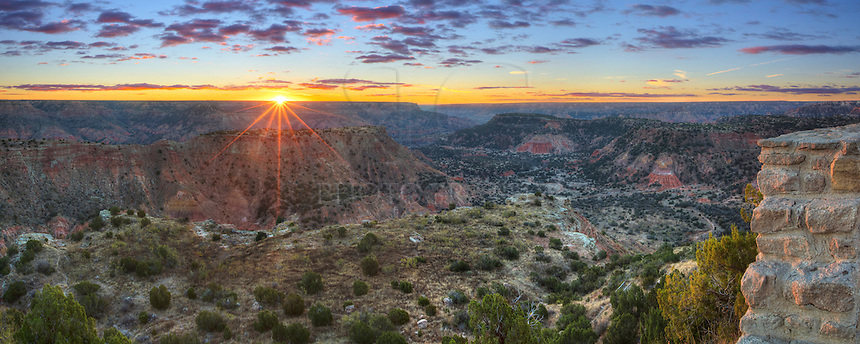 Palo Duro Canyon is an amazing place to visit in the Texas Panhandle. As the 2nd largest canyon in North America, this location offers miles of hiking and biking trails. This parorama taken at the visitor's center shows the first light of day as the sun rises over the distant ridges on a cold November morning.