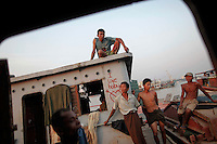 People who work and sleep on abandoned ships on the river rest in Yangon March 29, 2012. Aung San Suu Kyi, the long-time standard-bearer for democracy in Myanmar, is taking a leap of faith in running for parliament on Sunday, opting to enter a political system crafted and run by the soldiers who kept her locked up for a total of 15 years. Her party's participation in this weekend's by-elections marks a change of heart for the Nobel Peace Prize winner who repeatedly rebuffed the military's attempts to bring her into a political apparatus in which it dictated the terms. REUTERS/Damir Sagolj (MYANMAR)