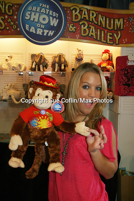- One Life To Live's Kristen Alderson poses with a monkey as she is guest host and signed autographs at The Coney Island Illuscination presented by Ringling Bros. and Barnum & Bailey - The Greatest Show on Earth on August 28, 2010 at Coney Island Boardwalk, New York. (Photo by Sue Coflin/Max Photos)