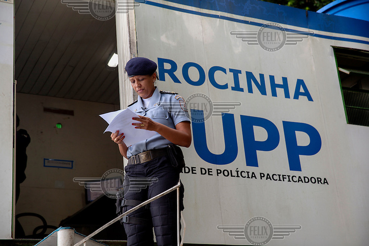 Major Priscilla (L) comander of the Rocinha UPP (Police Pacification Unit). The pacification policy aims to reduce violence in favelas and rest control from drug gangs.