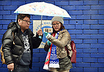 Everton fans standing in the rain outside Goodison Park before the start of the premier league match at Goodison Park Stadium, Liverpool. Picture date 7th April 2018. Picture credit should read: Robin Parker/Sportimage