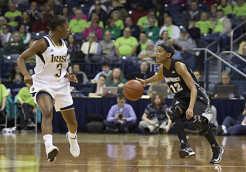 January 26, 2013:  Providence guard Symone Roberts (12) dribbles the ball as Notre Dame guard Whitney Holloway (3) defends during NCAA Basketball game action between the Notre Dame Fighting Irish and the Providence Friars at Purcell Pavilion at the Joyce Center in South Bend, Indiana.  Notre Dame defeated Providence 89-44.