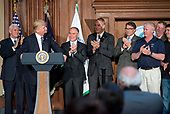 United States President Donald J. Trump makes remarks prior to signing an Energy Independence Executive Order at the Environmental Protection Agency (EPA) Headquarters in Washington, DC on Thursday, March 28, 2017.  The order reverses the Obama-era climate change policies. From left to right: US Vice President Mike Pence; the President; EPA Administrator Scott Pruitt; US Secretary of the Interior Ryan Zinke; US Secretary of Energy Rick Perry; and unidentified coal miners.<br /> Credit: Ron Sachs / Pool via CNP