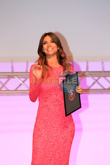 Miss Giro opens the 2014 Giro d'Italia Presentation held in the Palazzo del Ghiaccio in Milan, Italy. 7th October 2013.<br /> (Photo: Eoin Clarke/www.newsfile.ie)