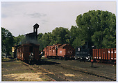 View north of Chama yard with Rotary OY and various cars.  Tank and coaling tower are in background.<br /> C&amp;TS  Chama yard, NM