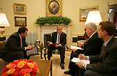 In this photo released by the White House, United States President George W. Bush, center left, reviews the text of an address with his speech writing staff Marc Thiessen, left,  Bill McGurn, right, and Christopher Michel, center right, in the Oval Office of the White House September 13, 2007 in Washington, DC. The President will address the nation during prime time on September 13 and is expected to announce plans for US troop reductions in Iraq. <br /> Mandatory Credit: Eric Draper / White House via CNP