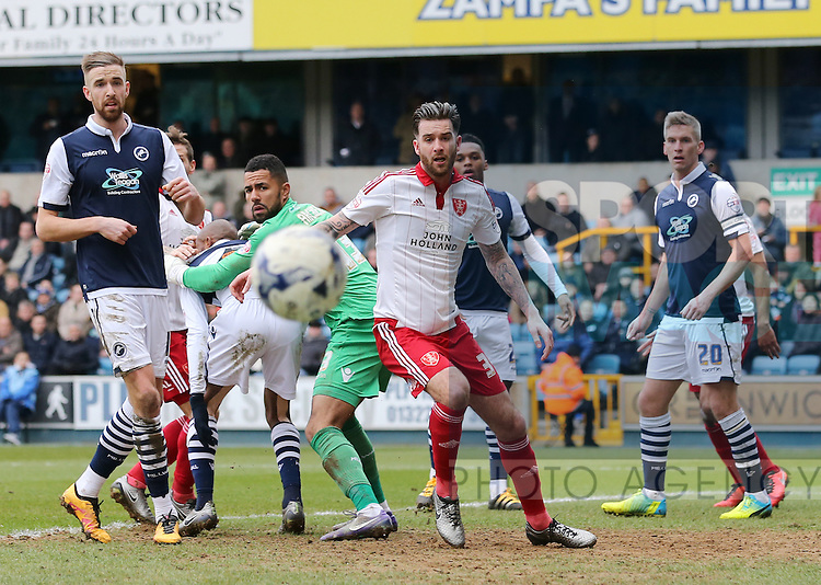 Millwall's Jordan Archer and Sheffield United's David Edgar watch the ball during the League One match at The Den.  Photo credit should read: David Klein/Sportimage