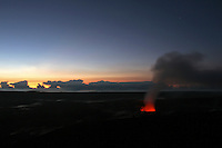 Lava and steam greet the sunrise at Kilauea Volcano's Halema'uma'u Crater, Hawai'i Volcanoes National Park, Big Island.