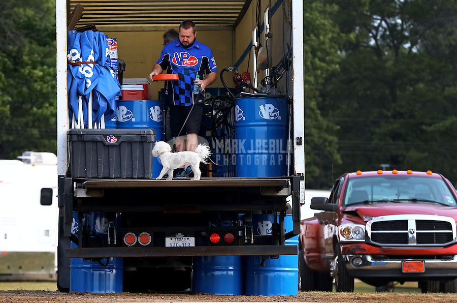 Aug. 18, 2013; Brainerd, MN, USA: A VP Racing crew in the back of the gas truck with a dog in the pits of the NHRA Lucas Oil Nationals at Brainerd International Raceway. Mandatory Credit: Mark J. Rebilas-