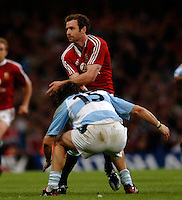 2005 British & Irish Lions vs Pumas [ Argentina], at The Millennium Stadium, Cardiff, WALES match played on  23.05.2005, Geordan Murphy un loads the ball before, Bernardo Stortoni, tackles..Photo  Peter Spurrier. .email images@intersport-images...
