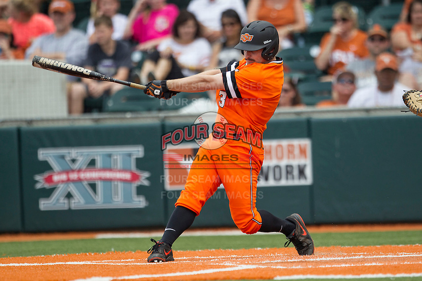 Oklahoma State Cowboys outfielder Saulyer Saxon #3 swings the bat during the NCAA baseball game against the Texas Longhorns on April 26, 2014 at UFCU Disch–Falk Field in Austin, Texas. The Cowboys defeated the Longhorns 2-1. (Andrew Woolley/Four Seam Images)