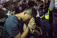 CHINA, Hong Kong: 13 August 2019 <br /> Xu Jinyang, who is suspected of being Chinese Police has his hands tied and is surrounded by both press and angry demonstrators at Hong Kong International Airport this evening. The man, who was caught with a Chinese ID badge, was almost kicked to death by the angry mob of protesters. Demonstrators have taken to the streets of Hong Kong in protest of a controversial extradition bill since 9th of June which has resulted in several violent clashes.<br /> Rick Findler / Story Picture Agency