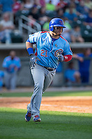 Dan Vogelbach (21) of the Tennessee Smokies hustles down the first base line against the Birmingham Barons at Regions Field on May 3, 2015 in Birmingham, Alabama.  The Smokies defeated the Barons 3-0.  (Brian Westerholt/Four Seam Images)