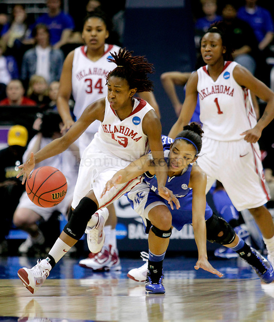 Oklahama junior guard Danielle Robinson and UK sophomore guard Keyla Snowden fight for a loose ball during the first half of their game on Tuesday, March 30, 2010 during the Kansas City Regional Final at the Sprint Center in Kansas City, Mo. Photo by Allie Garza | Staff