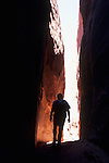 Hiker in slot canyon, Coyote Gulch, Grand Staircase-Escalante National Monument, Utah