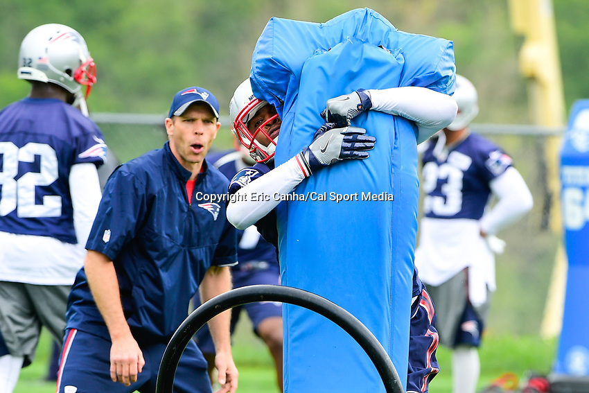June 7, 2017: New England Patriots defensive back Damarius Travis (45) hits a tackle dummy at the New England Patriots mini camp held on the practice field at Gillette Stadium, in Foxborough, Massachusetts. Eric Canha/CSM