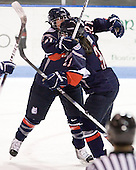 Jocelyn Slattery (UConn - 27), Kiana Nauheim (UConn - 3) - The visiting University of Connecticut Huskies defeated the Northeastern University Huskies 4-2 (EN) in NU's senior game on Saturday, February 19, 2011, at Matthews Arena in Boston, Massachusetts.