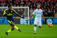 Alex Iwobi of Arsenal crosses the ball during the English Premier League game between Arsenal and Swansea at the Liberty Stadium in Swansea ,Wales, UK. Saturday 14 January 2017