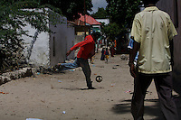 Boys play  on the street  in Mogadishu, Somalia on tuesday November 21 2006..Mogadishu, after 15 years of anarchy is now under the strong fist of the supreme Islamic Courts. Islamist militias are patrolling the streets keeping the city gun less.