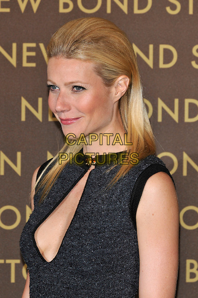 GWYNETH PALTROW .attends the launch of the Louis Vuitton Bond Street Maison Store in London, England, UK, May 25th, 2010. .portrait headshot black grey gray  cut out cleavage sleeveless trim gold toggle side profile .CAP/PL.©Phil Loftus/Capital Pictures.