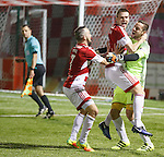 Mikey Devlin and Dougie Imrie celebrate with hero keeper Remi Matthews after winning penalty shootout