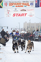 Martin Buser and team leave the ceremonial start line at 4th Avenue and D street in downtown Anchorage during the 2013 Iditarod race. Photo by Jim R. Kohl/IditarodPhotos.com