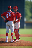Philadelphia Phillies catcher Jack Conley (23) and pitcher Kevin Gowdy (34) during a Minor League Spring Training game against the New York Yankees on March 23, 2019 at the New York Yankees Minor League Complex in Tampa, Florida.  (Mike Janes/Four Seam Images)
