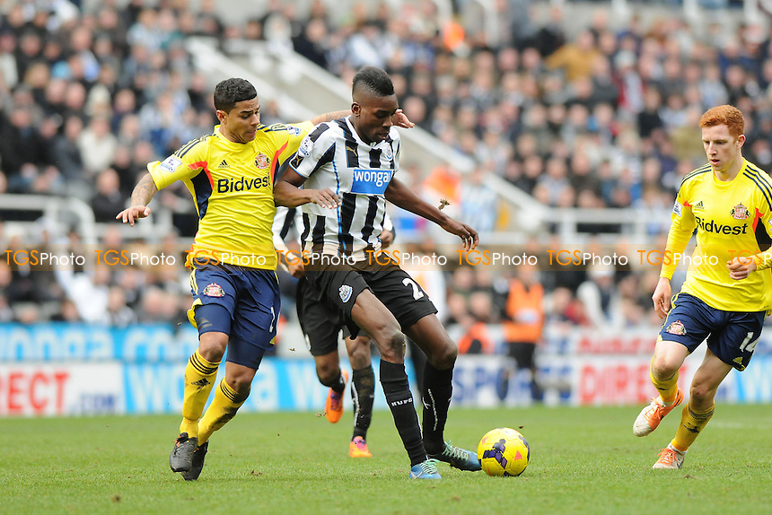Sammy Ameobi of Newcastle United battles with Liam Bridcutt of Sunderland - Newcastle United vs Sunderland - Barclays Premier League Football at St James Park, Newcastle upon Tyne - 01/02/14 - MANDATORY CREDIT: Steven White/TGSPHOTO - Self billing applies where appropriate - 0845 094 6026 - contact@tgsphoto.co.uk - NO UNPAID USE