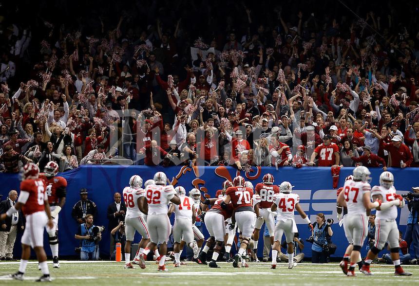 Alabama Crimson Tide fans celebrate a touchdown by running back Derrick Henry (27) during the first quarter of the Allstate Sugar Bowl college football playoff semifinal against the Ohio State Buckeyes at the Mercedes-Benz Superdome in New Orleans on Jan. 1, 2015. (Adam Cairns / The Columbus Dispatch)