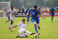 Cristian Flores (2) of the USA goes for a tackle on Brian Span (13) of the Academy Select Team. The US U-17 defeated the Academy Select team 3-1 during day one of the US Soccer Development Academy  Spring Showcase in Sarasota, FL, on May 22, 2009.