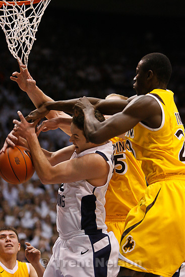 Trent Nelson  |  The Salt Lake Tribune.BYU's Logan Magnusson fights for a rebound as BYU hosts Wyoming, college basketball in Provo, Utah, Saturday, March 5, 2011. Wyoming's Djibril Thiam at right.