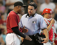 Astros manager Cecil Cooper argues with an umpire on Sunday May 25th at Minute Maid Park in Houston, Texas. Photo by Andrew Woolley / Baseball America.