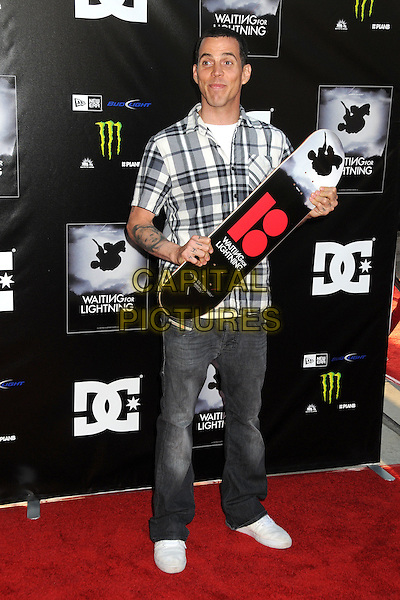 "Steve-O (Stephen Gilchrist Glover).""Waiting For Lightning"" Los Angeles Screening held at The Cinerama Dome, Hollywood, California, USA..April 10th, 2012.full length jeans denim grey gray check shirt skateboard white tattoos.CAP/ADM/BP.©Byron Purvis/AdMedia/Capital Pictures."