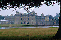 A view across the lake to the classical north facade of Badminton House which was thought to have been designed by John Webb