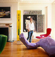 An eclectic collection of contemporary art frames Kenny Schachter's living room