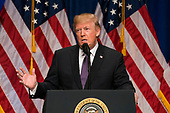 US President Donald J. Trump speaks on his 'America First' national security strategy in the Ronald Reagan Building and International Trade Center in Washington, DC, USA 18 December 2017. Trump's strategy puts American sovereignty over international relations, particularly on issues of border security. Credit: Jim LoScalzo / Pool via CNP