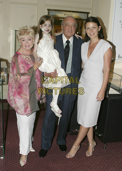 GLORIA HUNIFORD, KIRSTY HOWARD, MOHAMED AL FAYED & DAVINA McCALL.At Harrods. Goldsmiths tranform Kirsty's drawings into gems. All proceeds will go to raise money for the Kirsty Appeal..August 3rd, 2004.full length, child, kid, white silk, satin dress, floral print flowing top, sleeveless dress.www.capitalpictures.com.sales@capitalpictures.com.© Capital Pictures.