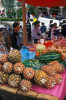 Pinenapples and watermelons for sale in the market in the old mining town of Angangueo, Michoacan, Mexico. Angangueo is the starting point for visits to the El Rosario and Sierra Chincua monarch butterfly sanctuaries.