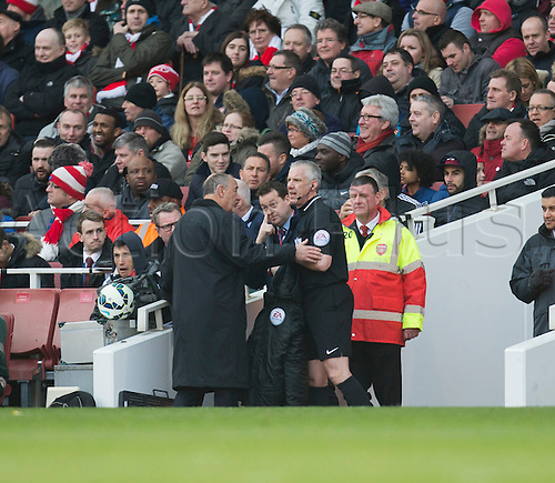 14.03.2015.  London, England. Barclays Premier League. Arsenal versus West Ham. Referee Chris Foy is replaced early in the second half due to a leg injury