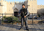 "An Israeli policeman stands guard at the scene of killed of a man who attempted to carry out a knife attack at the Damascus Gate at the entrance of the Old City in east Jerusalem on October 14, 2015. Israeli police said a ""terrorist"" attempted to stab a security guard at an entrance to Jerusalem's Old City but was shot before harming anyone, the latest in a wave of such incidents. Photo by Mahfouz Abu Turk"