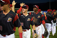 Batavia Muckdogs Matthew Brooks (46) and Thomas Jones (49) high five teammates after a game against the Auburn Doubledays on June 19, 2017 at Dwyer Stadium in Batavia, New York.  Batavia defeated Auburn 8-2 in both teams opening game of the season.  (Mike Janes/Four Seam Images)