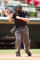 Home plate umpire Johnny Conrad makes a strike call during an International League game between the Toledo Mudhens and the Charlotte Knights at Knights Stadium August 8, 2010, in Fort Mill, South Carolina.  Photo by Brian Westerholt / Four Seam Images
